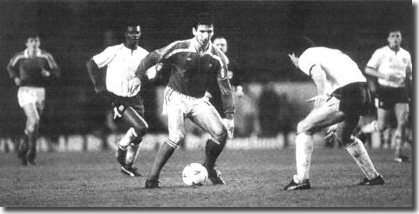 Cantona in action for France in the Under 21 match with England in 1988