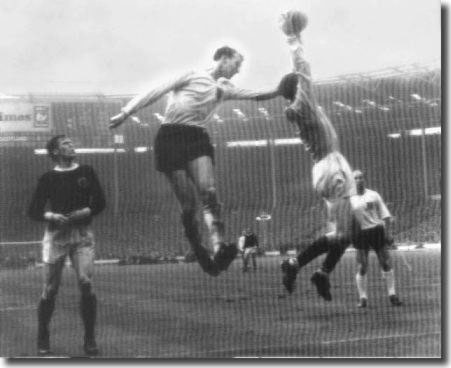 Jack in action during his England debut against Scotland. Billy McNeill and brother Bobby look on as Bill Brown catches this cross