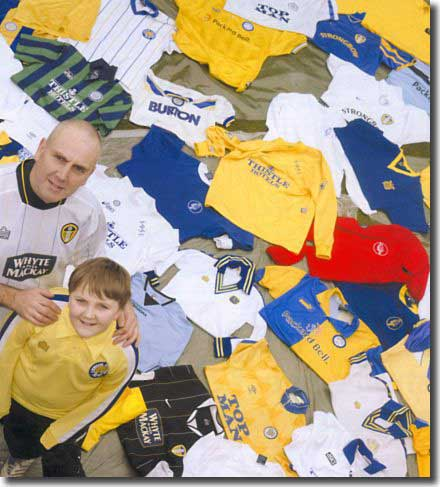 Leeds United fan Paul Waite with his 11-year-old son Alex and his collection of Leeds shirts as pictured in the March 2006 edition of the Leeds Leeds Leeds magazine
