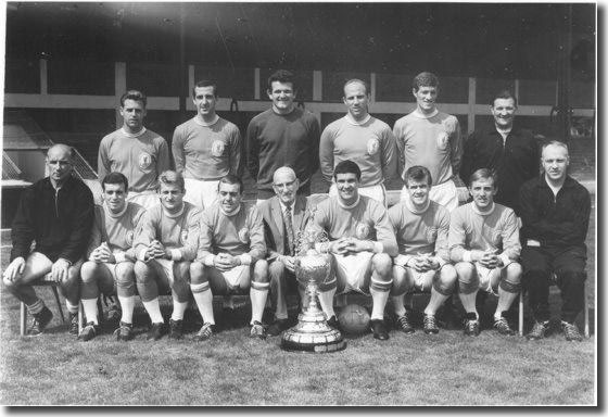 Liverpool 1963-64 with the championship trophy - Back: Milne, Byrne, Lawrence, Moran, Stevenson, Paisley (Trainer) - Front: Bennett (Coach), Callaghan, Hunt, St John, Williams (President), Yeats, Arrowsmith, Thompson, Shankly (Manager)