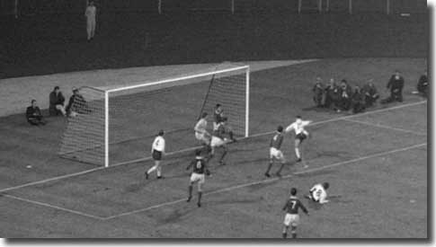Alan Peacock on the right hooks home the winner for England against Northern Ireland on 10 November 1965