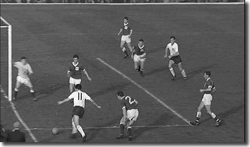 Mike O'Grady (11) flashes over a centre against Northern Ireland with Alan Peacock moving in for the kill - the chance was missed - 20 October 1962