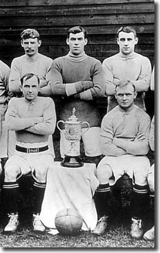 Billy Scott is in the middle of the back row with the old FA Cup after Everton's win in 1906