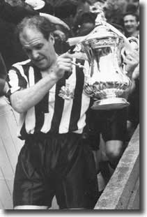 Jimmy Scoular lifts the FA Cup for Newcastle in 1955 after beating Manchester City